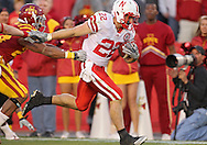 November 06 2010: Nebraska Cornhuskers running back Rex Burkhead (22) pulls away from the defenders as he scores a touchdown on a 19 yard run during overtime of the NCAA football game between the Nebraska Cornhuskers and the Iowa State Cyclones at Jack Trice Stadium in Ames, Iowa on Saturday November 6, 2010. Nebraska defeated Iowa State 31-30.