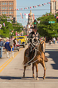 A cowboy shows off roping skills during the Cheyenne Frontier Days parade past the state capital building July 23, 2015 in Cheyenne, Wyoming. Frontier Days celebrates the cowboy traditions of the west with a rodeo, parade and fair.