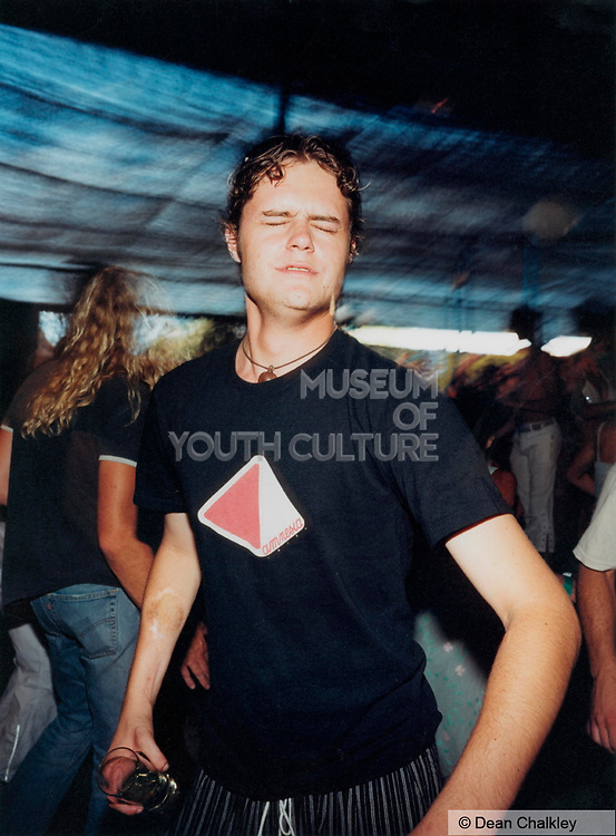 Man dancing with his eyes closed at Space, Ibiza 2001
