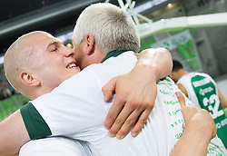 Edo Muric of Krka and Miro Zupevc of Krka celebrate after winning the basketball match between KK Krka and KK Union Olimpija in 4th Final match of Telemach League 2012/13 on May 20, 2013 in Arena Stozice, Ljubljana, Slovenia. Krka defeated Union Olimpija third times and become Slovenian Champions 2013. (Photo By Vid Ponikvar / Sportida)