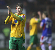 Carlisle - Saturday November 28th, 2009: Wesley Houlahan of Norwich City applauds the fans after the final whistle during the FA Cup second round match at Brunton Park, Carlisle. (Pic by Andrew Stunell/Focus Images)..