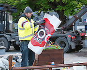 Galway City Council worker removes Labour party banner from  the removal of the occupy Galway protest  from Eyre Square Galway. Photo:Andrew Downes