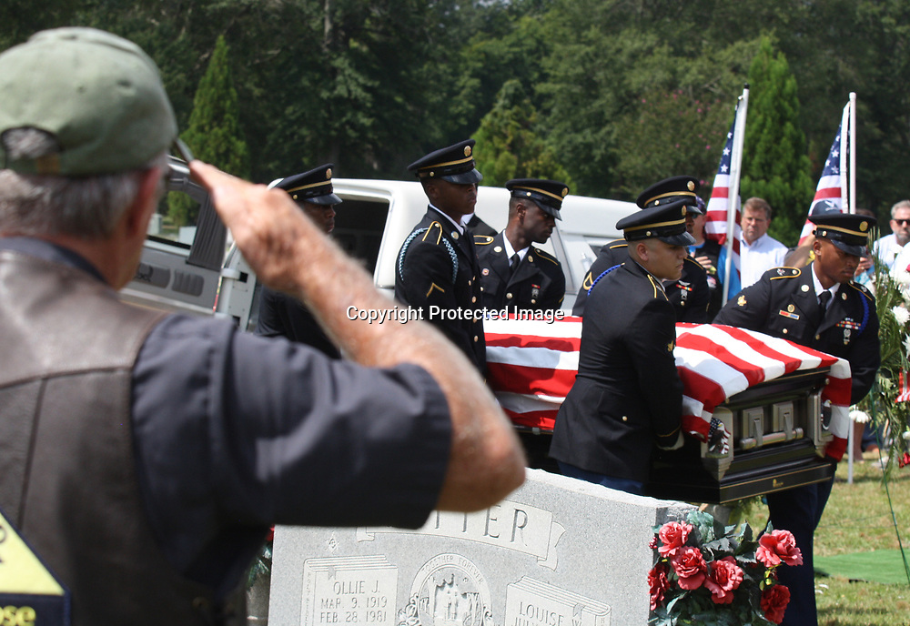 JOHN WARD/BUY AT PHOTOS.MONROECOUNTYJOURNAL.COM<br /> A member of the Patriot Guard salutes as the casket of Command Sgt. Major Lawrence E. &quot;Rabbit&quot; Kennedy is carried to his final resting place at Masonic Cemetery in Amory Aug. 4. The highly decorated veteran of World War II and the Korean and Vietnam wars was raised in Smithville, lived in Wren after serving 35 years in the U.S. Army and passed away at Oak Tree Manor in Amory July 30 at age 93. A funeral procession through Amory gave people an opportunity to pay tribute to the well-known veteran.