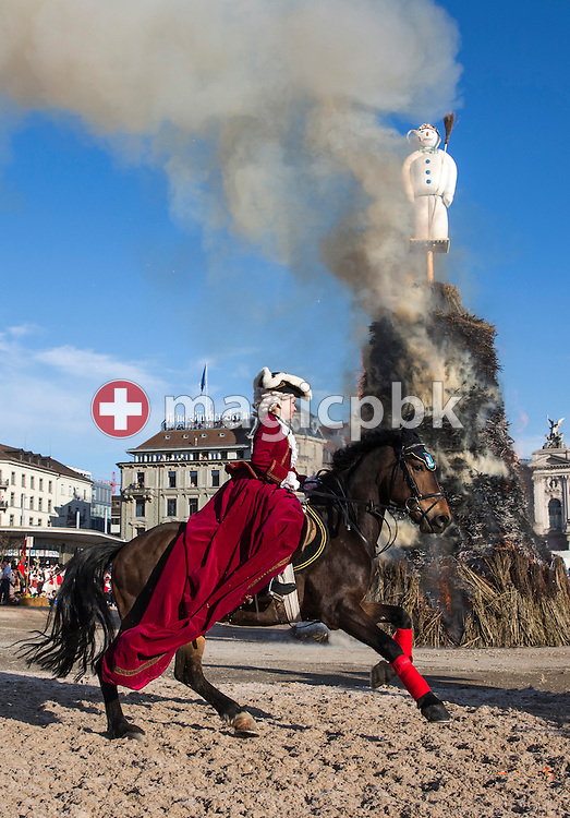 "A woman of the guild ""Hardd"" rides around the ""Boeoegg"" on the Sechselaeuten meadow in Zurich, Switzerland, pictured on April 15, 2013. The Sechselaeuten (ringing of the six o'clock bells) is a traditional end of winter festival with a parade of guilds in historical uniforms on horseback and the burning of the Boeoegg, a symbolic snowman, at 6 pm. The faster the Boeoegg explodes, the hotter the summer will be according to traditional weather rules.  (Photo by Patrick B. Kraemer / MAGICPBK)"