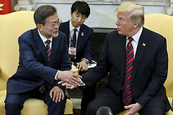 President Donald Trump shakes hands with South Korean President Moon Jae-in during a meeting in the Oval Office of the White House on May 22, 2018 in Washington DC.<br /> (Photo by Oliver Contreras/SIPA USA)