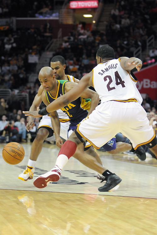 March 6, 2011; Cleveland, OH, USA; New Orleans Hornets point guard Jarrett Jack (2) drives between Cleveland Cavaliers point guard Ramon Sessions (3) and power forward Samardo Samuels (24) at Quicken Loans Arena. The Hornets beat the Cavaliers 96-81. Mandatory Credit: Jason Miller-US PRESSWIRE