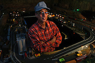 Wally Reyes in his sacred space - his garage- with his train set.   Kathy Moore/staff Metro