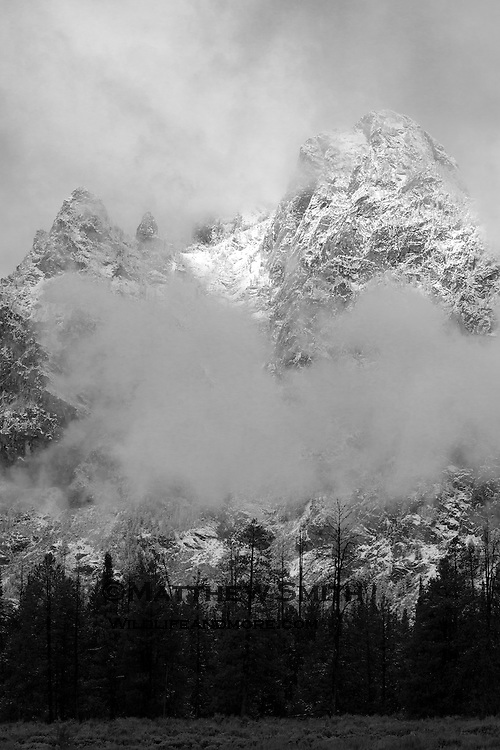 A black and white cloudy mountain peak in Grand Teton National Park Wyoming