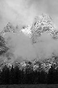 A black and white cloudy mountain peak in Grand Teton National Park Wyoming