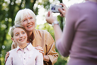 Grandmother With Granddaughter Posing For Photograph