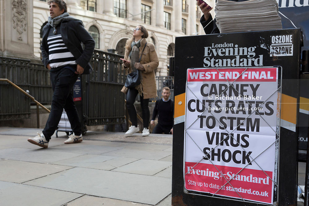 On the day that Chancellor of the Exchequer Rishi Sunak unveiled a £30bn package to boost the economy and get the country through the coronavirus outbreak, a headline appears at Bank Underground Station in the capital's financial district, about the Bank of England's governor Mark Carney cut the interest rate from 0.75% to 0.25%, on 11th March 2020, in the City of London, England.