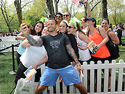 "Bob Harper, trainer on ""The Biggest Loser,"" poses with fans at SELF magazine's 21st annual Workout in the Park, Saturday, May 10, 2014, in New York's Central Park, where he signed copies of his newest book ""Skinny Meals"" and later led the crowd in a body-blasting workout. (Photo by Diane Bondareff/Invision for SELF/AP Images)"