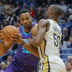 Mar 13, 2018; New Orleans, LA, USA; Charlotte Hornets center Dwight Howard (12) drives past New Orleans Pelicans center Emeka Okafor (50) during the first quarter of a game at the Smoothie King Center. Mandatory Credit: Derick E. Hingle-USA TODAY Sports