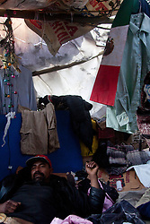 """Tijuana 2015<br /> Interior of a """"ñongo"""" a migrant house made by scarce resources, mainly garbage.<br /> <br /> Un interno delle capanne improvvisate a fianco della frontiera. Il cosidetto """"bordo""""."""