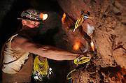 Training instructor, Bryan King, instructs mining engineering students in loading blasting powder during training at the San Xavier Mining Laboratory Training Center, University of Arizona, Tucson, Arizona, USA.