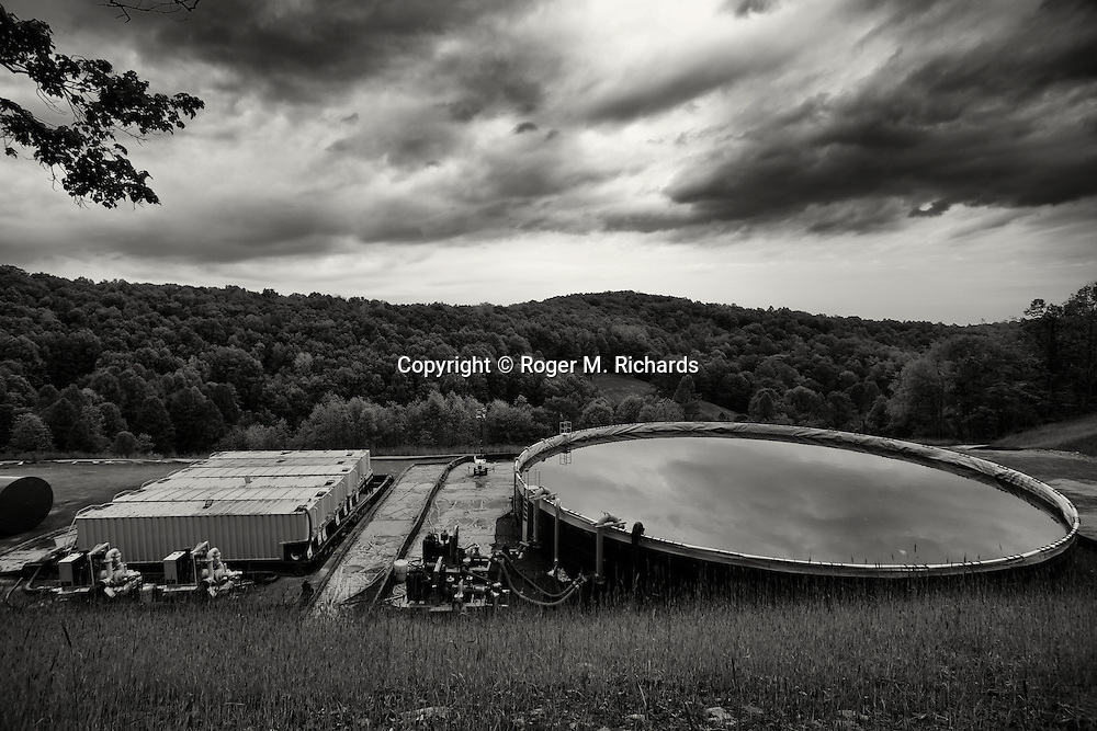 A waste water runoff pool near an oil drilling rig in Doddridge County, West Virginia. The Marcellus Shale formation that runs under West Virginia contains some of the richest deposits of oil and gas in the world. This has led to a boom in hydraulic fracturing (fracking) in the state and region, with some economic benefits but mainly negative consequences for residents way of life and the environment of the area.
