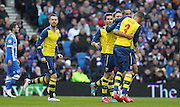 Arsenal's Theo Walcott celebrates his goal during the The FA Cup match between Brighton and Hove Albion and Arsenal at the American Express Community Stadium, Brighton and Hove, England on 25 January 2015. Photo by Phil Duncan.