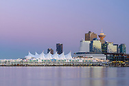 Earth's shadow (the Belt of Venus) behind downtown Vancouver's Canada Place and the Trade and Convention Center building in Vancouver, British Columbia, Canada