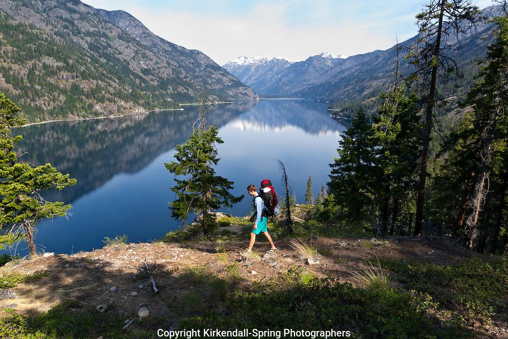 WA11389-00...WASHINGTON - Michael Spring hiking the Lake Chelan Trail between Moor Point and Stehekin, Lake Chelan National Recreation Area. (MR# S4)