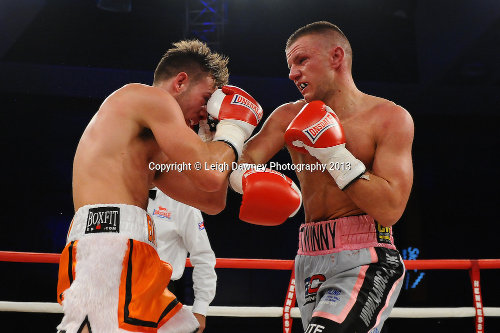Chris Jenkinson & Adam Battle exchange blows in a Light Middleweight contest. Glow, Bluewater, Kent, UK. Hennessy Sports © Leigh Dawney Photography 2013.
