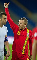 CARDIFF, WALES - Friday, October 11, 2013: Wales' Craig Bellamy salutes the supporters as he walks off the pitch following his final home game for his country during the 2014 FIFA World Cup Brazil Qualifying Group A match against Macedonia at the Cardiff City Stadium. (Pic by David Rawcliffe/Propaganda)