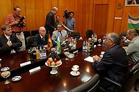 10 AUG 2003, TASCHKENT/USBEKISTAN:<br /> Peter Struck (2.v.L.), SPD, Bundesverteidigungsminister, und Kadir Guljamov (R), Verteidigungsminister Usbekistan, vor einem Gespraech, Verteigungsministerium von Usbekistan<br /> IMAGE: 20030810-01-057<br /> KEYWORDS: Streitkraefte, Streitkräfte,  Tashkent, Uzbekistan