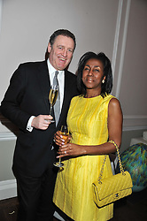 ANDREW & THERESA ROBERTS at a champagne reception to launch The Big Egg Hunt presented by Faberge in aid of the charities Action for Children and Elephant Family held at 29 Portland Place, London on 18th January 2012.