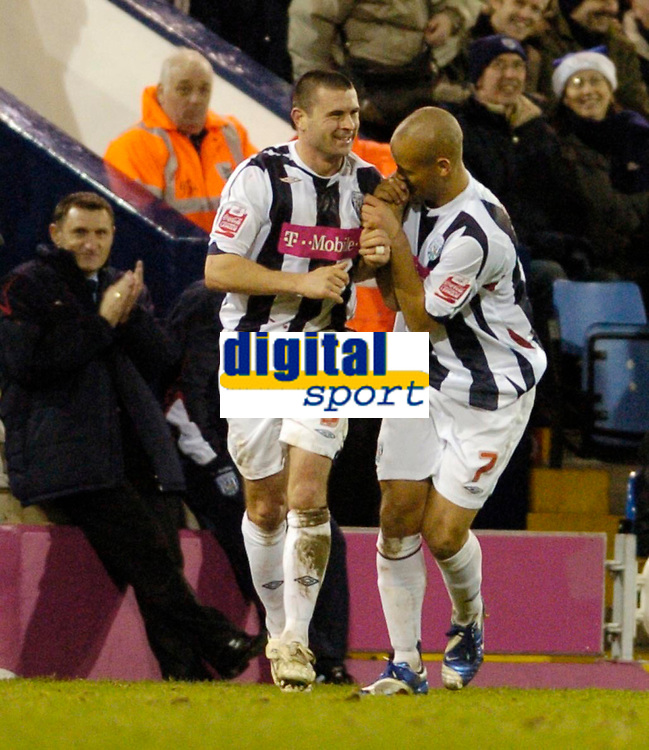 Photo: Leigh Quinnell.<br /> West Bromwich Albion v Coventry City. Coca Cola Championship. 16/12/2006. West Broms Nigel Quashie congratulates Paul Robinson(L) on his goal.
