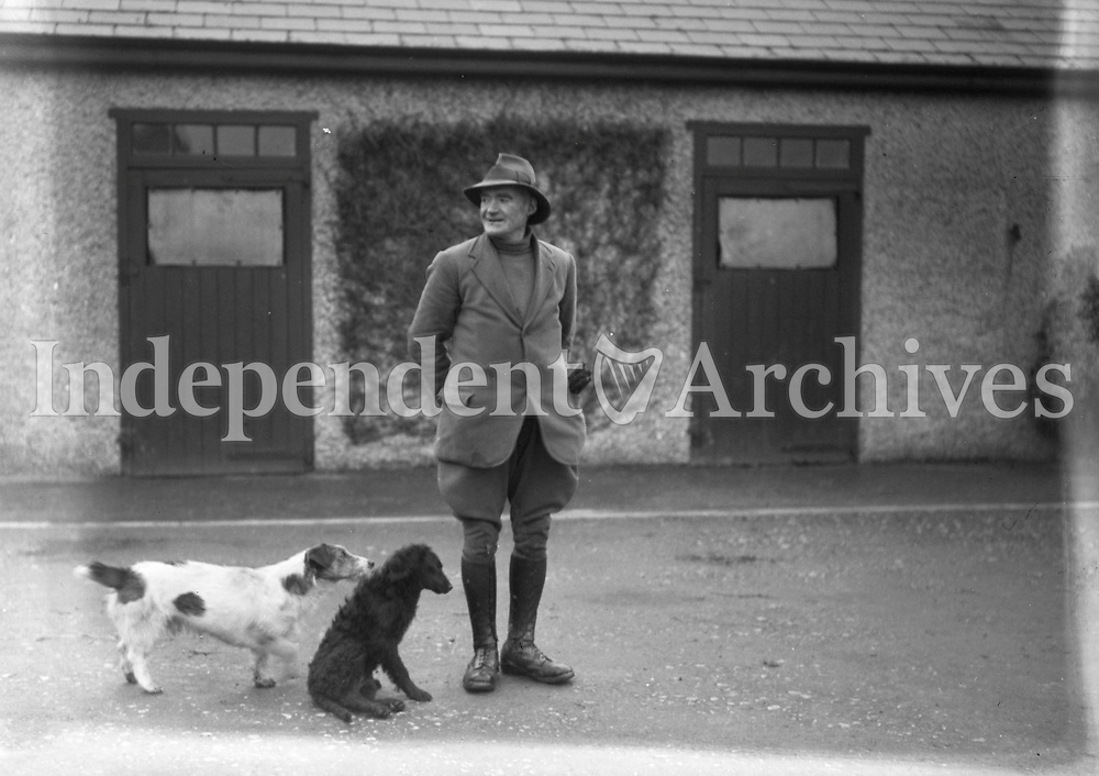H1566 Stud Farm - Cloghran. Man with dogs (Trainer?). 26/2/31<br /> <br /> <br /> <br /> (Part of the Independent Ireland Newspapers/NLI Collection) <br /> Farming