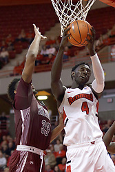 """08 February 2018:  Cornered by Kavion Pippen, Daouda """"David"""" Ndiaye looks for the hoop with a reverse during a College mens basketball game between the Southern Illinois Salukis and Illinois State Redbirds in Redbird Arena, Normal IL"""