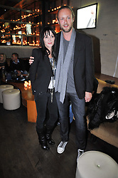 LORD EDWARD SPENCER-CHURCHILL and Annabelle Neilson at a party to celebrate the launch of the Omega 2009 Constellation Collection of watches held at Almada, Berkeley Street, London on 15th October 2009.