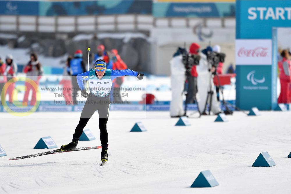 REPTYUKH Ihor UKR LW8 competing in the ParaSkiDeFond, Para Nordic Skiing, 20km at  the PyeongChang2018 Winter Paralympic Games, South Korea.