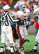 Denver Broncos linebacker Mike Croel (51) is held by an NFL referee after recovering a fumble during the 1993 NFL regular season football game against the Chicago Bears on Dec. 18, 1993 in Chicago. The Broncos won the game 13-3. (©Paul Anthony Spinelli)