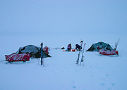 Evening camp during a white out. British mountaineering expedition to Knud Rasmussens Land, East Greenland, Arctic, 2006.
