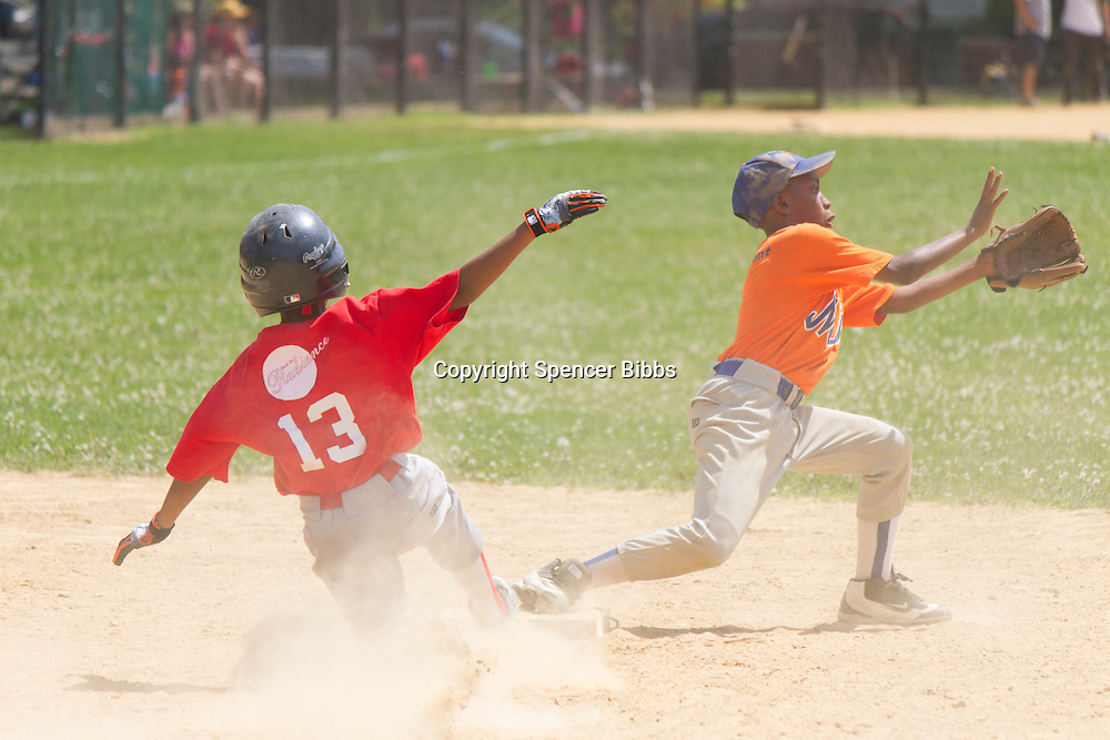 """The Hyde Park Kenwood Legends baseball league held its all-star games this Saturday afternoon at Kenwood Park located at 49th and Dorchester.<br /> <br /> 0411 – Ellis Tyler slides into second base as Julian Doyle tries to make the play during the Minor Division game.<br /> <br /> Please 'Like' """"Spencer Bibbs Photography"""" on Facebook.<br /> <br /> All rights to this photo are owned by Spencer Bibbs of Spencer Bibbs Photography and may only be used in any way shape or form, whole or in part with written permission by the owner of the photo, Spencer Bibbs.<br /> <br /> For all of your photography needs, please contact Spencer Bibbs at 773-895-4744. I can also be reached in the following ways:<br /> <br /> Website – www.spbdigitalconcepts.photoshelter.com<br /> <br /> Text - Text """"Spencer Bibbs"""" to 72727<br /> <br /> Email – spencerbibbsphotography@yahoo.com"""