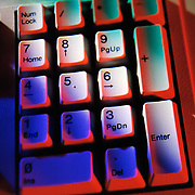 10 Key numeric keyboard colored with red, green and blue light. Selective focus.