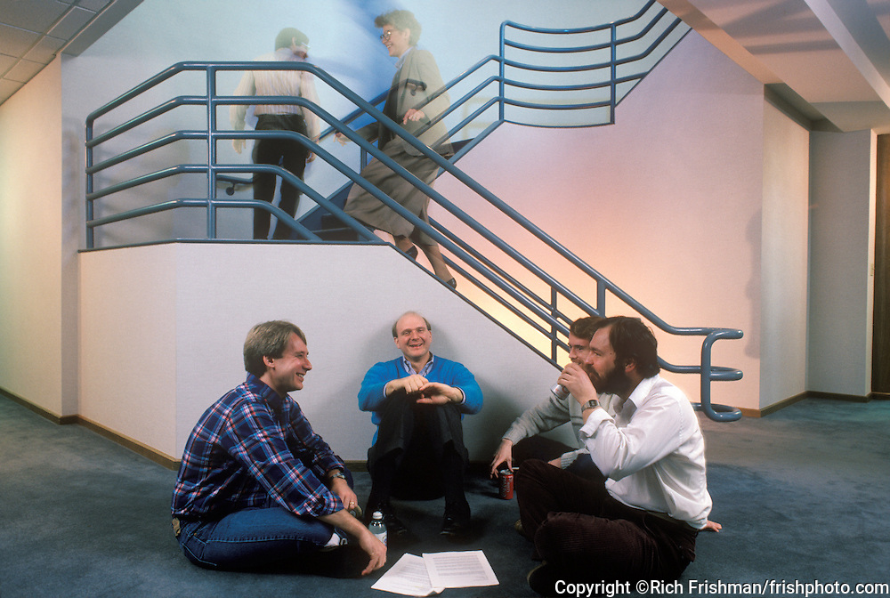 Steve Ballmer sits on floor by stairs and brainstorms with Microsoft software engineers in their new building in February 1987...©Rich Frishman/frishphoto.com