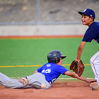 062915       Cable Hoover<br /> <br /> Dodger Isaac Espinosa (3) dives back to second base as the pickoff throw to Yankee Talon West (8) falls short Monday at Ford Canyon Park.