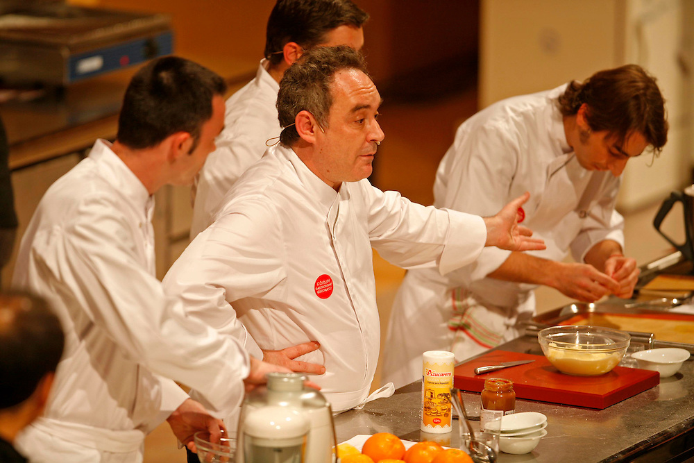 The best Catalan cooks of the guide Michelin. Chefs Ferran Adria (center) of restaurant El Bulli and Jordi Roca (extreme right) of restaurant El Celler de Can Roca, in a gastronomical exhibition.