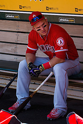 OAKLAND, CA - APRIL 13:  Mike Trout #27 of the Los Angeles Angels of Anaheim sits in the dugout wearing black and gold Nike batting gloves in honor of Kobe Bryant's retirement before the game against the Oakland Athletics at the Coliseum on April 13, 2016 in Oakland, California. (Photo by Jason O. Watson/Getty Images) *** Local Caption *** Mike Trout