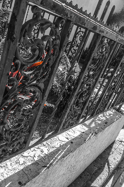 Iron fence, two-tone (red), Ybor City (Tampa), Florida. Photo by Richard M. Porter