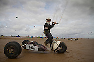 Thierry Guibal of France, one of the competitors, preparing to get into his buggy before one of the races at the European Kite Buggy Championships at Hoylake, Wirral, north west England. Around 75 buggies, with both male and female pilots, from 10 countries took part in the annual event which lasted from 5-9 September 2011. The three-wheeled, single-seated, steel frame buggy was powered  by a traction, or power kite and could achieve speeds of up to 70mph/110km/h.