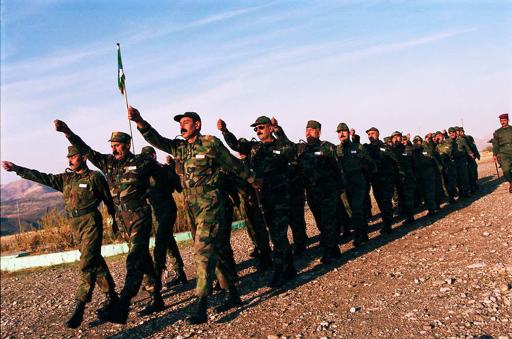Traditional Kurdish Peshmerga guerrilla fighter commanders attend a six month officer training course in military theory and strategy at the Kurdish military college. The Kurds of northern Iraq are training a standing regular army in addition to the Peshmerga militias...Sulaimaniya, Iraqi Kurdistan. 24/11/2002...Photo © J.B. Russell