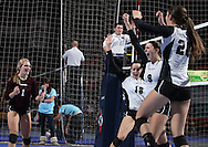 Mount Vernon's Kylea Weber (1), Amanda Platte (18), Taylor Dicus (9), and Ali Stark (20) celebrate after a score during the second game of a 3A semifinal in the state volleyball tournament at the U.S. Cellular Center at 370 1st Ave E on Friday afternoon, November 12, 2010. (Stephen Mally/Freelance)