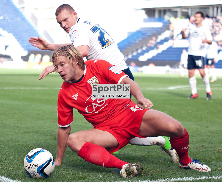 MK Dons Alan Smith vies for the ball with Preston's Stuart Beavon - Preston North End v MK Dons NPower League One Deepdale 14 October 2012 (c) Greig Bertram | StockPix.eu