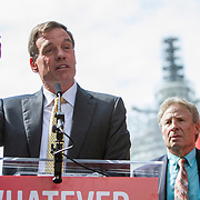 "Virginia Senator, Mark Warner speaks at a rally organized to support victims of gun violence and pressure politicians to do ""whatever it takes"" to prevent gun violence.  Andy Parker, right, made his first visit to Washington, D.C. since his daughter, WDBJ_TV reporter, Alison Parker, was shot and killed on live television near Roanoke, VA last week.  The rally, organized by Everytown for Gun Safety, brought Parker together with Virginia Senators, Mark Warner, Tim Kaine and Virginia Governor, Terry McAuliffe near the United States Capitol, on Thursday, September 10, 2015.  John Boal/for The New York Daily News"