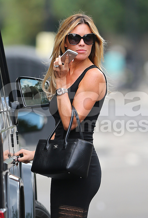 Model Abbey Clancy looking stunning wearing a black maxi dress, sandals and carring Chanel handbag out running errands in London, UK. 25/07/2014<br />