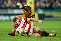Henry Purdy of Gloucester Rugby is challenged by Jason Woodward of Bristol Rugby - Rogan Thomson/JMP - 03/12/2016 - RUGBY UNION - Kingsholm Stadium - Gloucester, England - Gloucester Rugby v Bristol Rugby - Aviva Premiership.