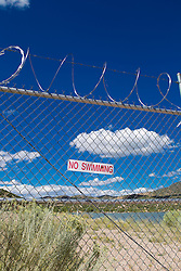 no swimming sign on a chain link fence in New Mexico