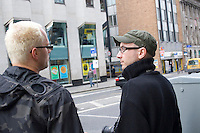 Two men wearins simular glasses on Dame Street in Dublin Ireland
